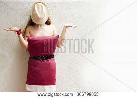Surprised Woman In A Red Bedding Pillow Challenge Dress And A Hat In Her Face. Challenge Due To Home