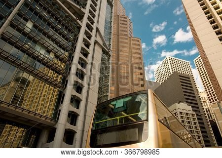 Bus At Des Voeux Road And Skyline Of Buildings  At Central District, Hong Kong Island, Hong Kong, Ch