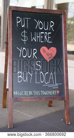 Chandler,Az/USA - 5.16.20: Shoethrill is a locally owned European comfort shoe store opened in 2012.  A Hand drawn buy local chalk board sign outside the store reminds locals to show their love.