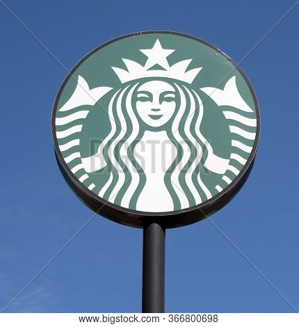 Phoenix,Az/USA -5.13.20:Starbucks Corp American multinational coffeehouses and roastery headquartered in Seattle, WA Despite changes to the logo, Starbucks still maintains the Mermaid icon.