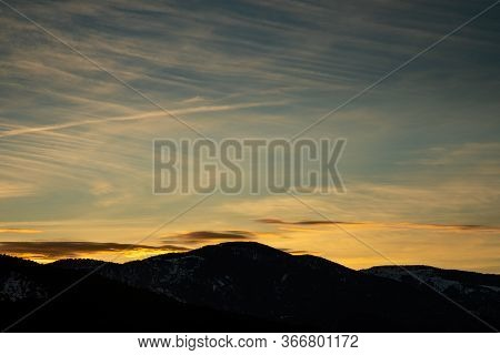 Snowy Mountains Silhouette In Catalonia With Clear Sky During Sunset And Copy Space