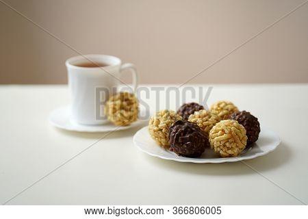 Sweet Dessert Chak Chak Tatar Dish On A White Plate With A Cup Of Tea On A White Plate On A White Ta