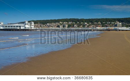 Weston-super-Mare beach in Somerset England.  A very popular tourist attraction poster