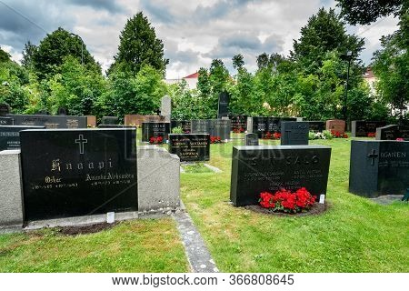 Turku, Finland - July 13, 2016: Summer View Of An Open City Park Cemetery With Black Inscribed Grave
