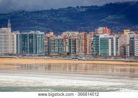 Gijon, Spain - January 25, 2019: Residential Buildings Over San Lorenzo Beach In Gijon City, Northwe