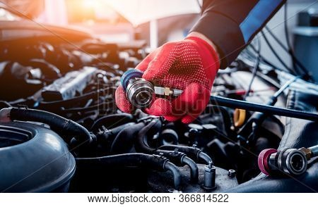 Servicing Car Air Conditioner. Auto Service Station.