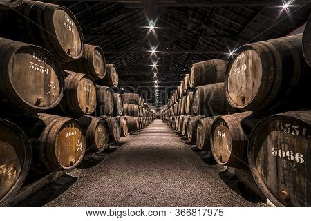 Vila Nova De Gaia, Porto, Portugal - Nov.22, 2019: Taylor's Port Wine Cellar. Barrels Filled With Wi
