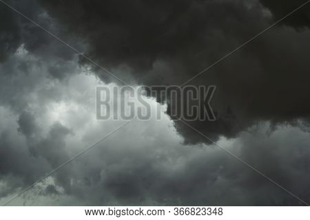 The Dark Sky With Black Clouds Covered Before The Big Storm Will Enter. The Big Powerful Storm Cloud