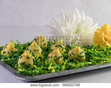 Yellow And Green Decorated Pineapple Upside Down Cake Pop Balls Arranged On A Rustic Metal Tray With