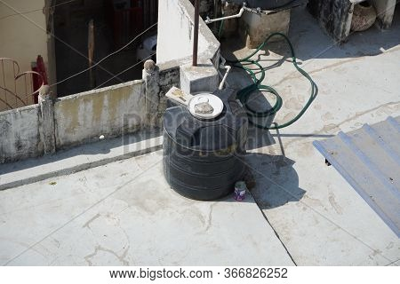 Polyvinyl Chloride Pvc Water Pipes Connected To Unidentified Overhead Tank. Black Water Tanks Of Ind