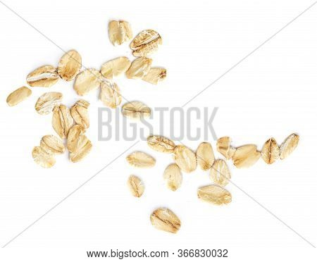 Oat Flakes Isolated On White Background. Falling Oats Macro. Oatmeal Top View