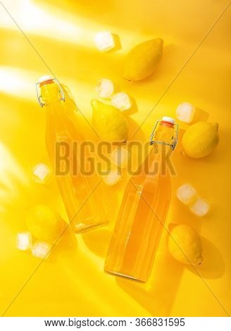Lemonade In Glass Bottles Top Down View, Bright Sunny Summer Home Healthy Culinary Concept