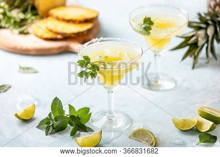 Pineapple Coriander Infused Margarita In Glasses With Ingredients, Front View