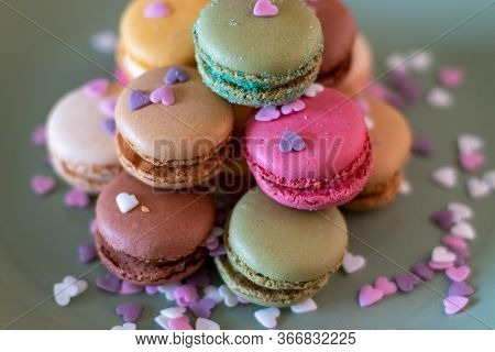 Colorful Macarons On Black Background, Close Up View