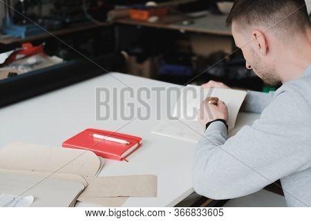 Portrait Of A Clothing Designer Or Engineer At A Generic Workshop. Small Business, Local Enterpreneu