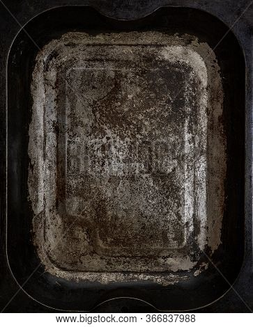 Worn Metallic Baking Tray Textured With Scratches And Cracks.