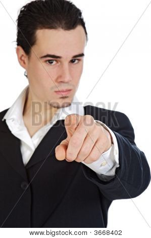 Attractive Young Person Businessman Indicating With The Finger, The Center Of The Center Of Focus In
