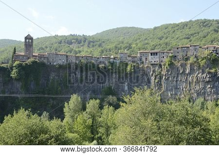 Houses Of The Small Town Castellfollit De La Roca Rised Up On A Basalt Crag, Girona, Catalonia, Spai