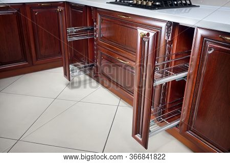 Pull Out Rack Cabinet Filler Pantry. Two Vertical Drawers For Shelf Under Countertop With Wooden Pan