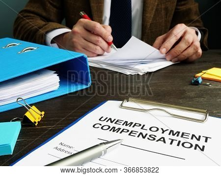 Unemployment Compensation Application And Clerk With Papers.