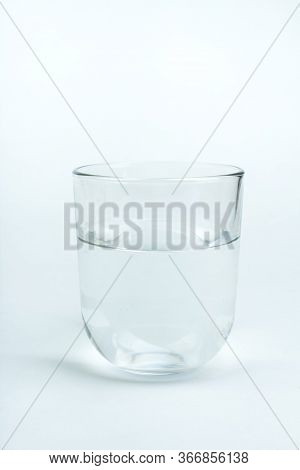 Glass Of Clean Water Isolated On White.