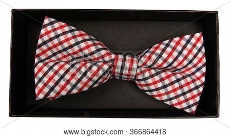 Red white and black plaid bow tie isolated in box on white background