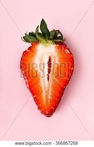 Beautiful Juicy Half Strawberries On A Pink Background. Macro Of Sliced Strawberries.