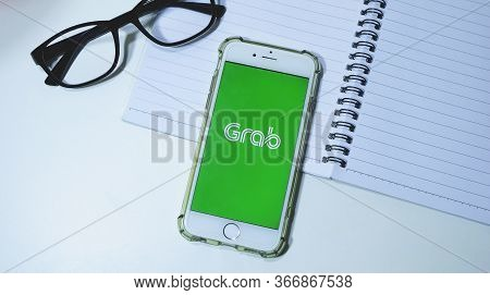 Chiang Mai, Thailand - May 18,2020: Flat Lay Of Workspace Desk And Apple Iphone 6s With Grab Applica