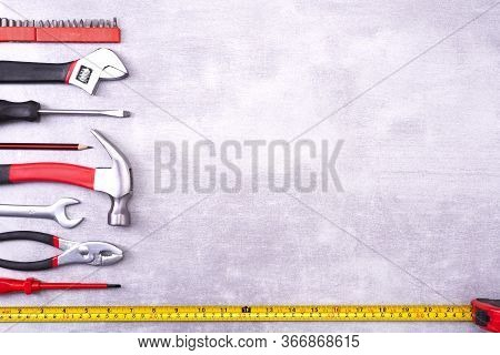 Various Repair Tools On A Gray Background. Equipment For Construction. Repair Tool Kit. Top View Tem