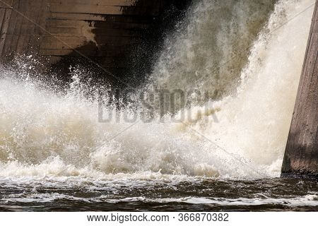 Water Spray And Foam From Falling Through A Lock In A Dam On The River. River Dam Old