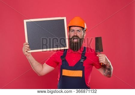 Professional Plasterer. Skillful Plasterer. Successful Renovation. Bearded Man Worker With Plasterin
