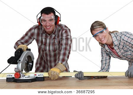 Couple using circular saw poster