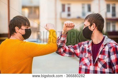 Elbows Bump. Fight Coronavirus. Friends Bump Elbows Outdoors. Coronavirus Epidemic. Health Care. Soc