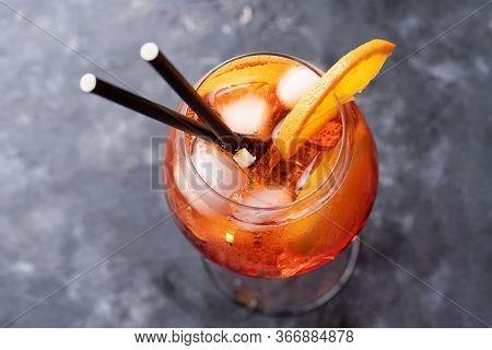 Classic Italian Aperitif Aperol Spritz Cocktail In Glass With Slice Of Orange On Dark Background, To