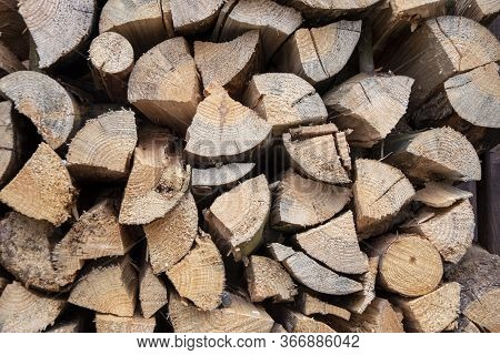 Chopped Wood For Lighting A Fire Is Stacked In A Woodpile, Backgrounds And Texture 1.