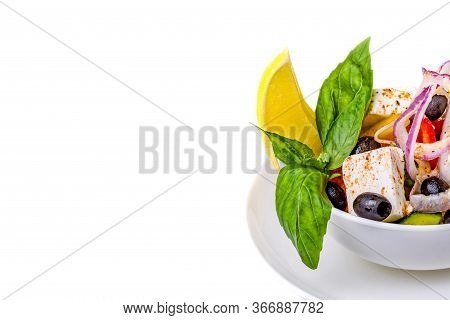 Juicy Greek Salad On A White Background. Salad Of Cheese, Olives, Onions, Tomatoes And Cucumbers, De