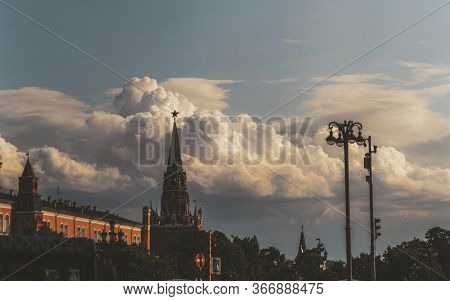 The Silhouette Of Moscow Kremlin Near The Red Square On A Sunny Evening And A Stunning Cloudscape In