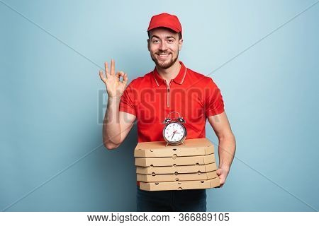 Courier Is Punctual To Deliver Quickly Pizzas. Cyan Background.