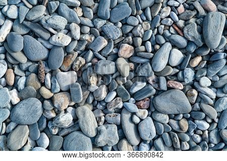 Blue Pebbles Closeup. Blue Pebbles. Background From A Natural Stone Of Blue, Turquoise Hue. Pebbles