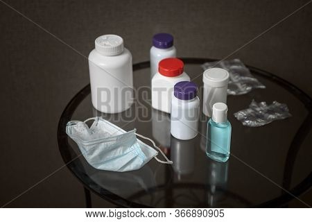 Medicine Chest . A Used Coronavirus Mask, Vials Of Medication, And Disinfectant Are On The Bedside T
