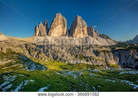 Famous place - Tre Cime di Lavaredo Mountains at summer with blue sky, Dolomites Alps, Italy