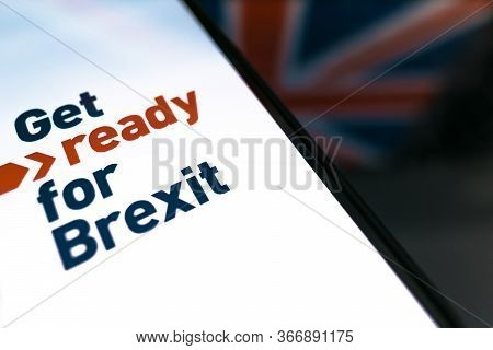 Hand Holds Smartphone With Text. Get Ready For Brexit.