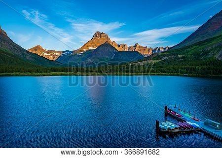 2570 Morning Sun Brightens Mount Wilbur At Swiftcurrent Lake, Glacier National Park  Montana