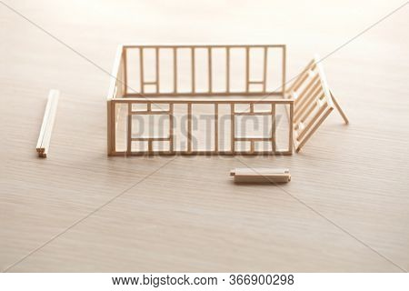 Building a house or a home. Frame work of a house with walls being erected.