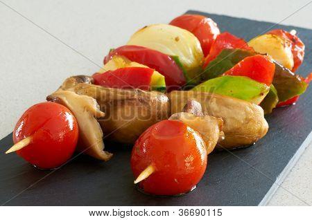 Vegetable Brochettes On A Black Slate Tray