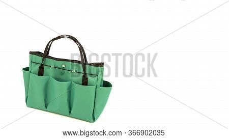 Isolated Green Handbag. Green Bag Multi Purpose With Pockets. Green Bag For Gardening. Photo With Co