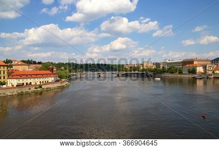 View From Charles Bridge To Vltava, Mánes Bridge, On Sky Background With Clouds