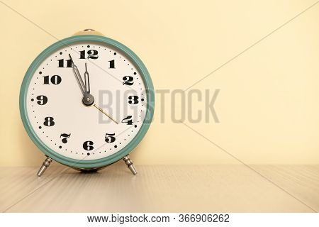 Antique Analog Clock With Hands Set At 12:00. 11:55 A.m. 00:00 12:00 24:00. The Alarm Clock Is On Th