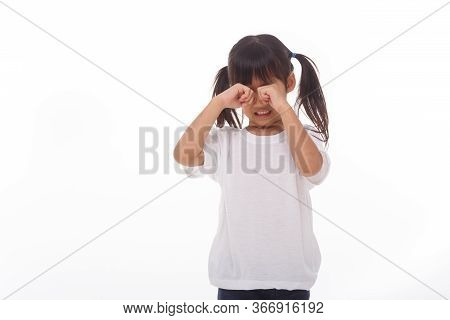 Portrait Of Little Girl Crying.on White Background.