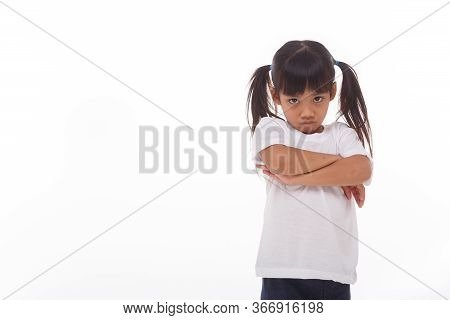 The Angry Little Girl On A White Background